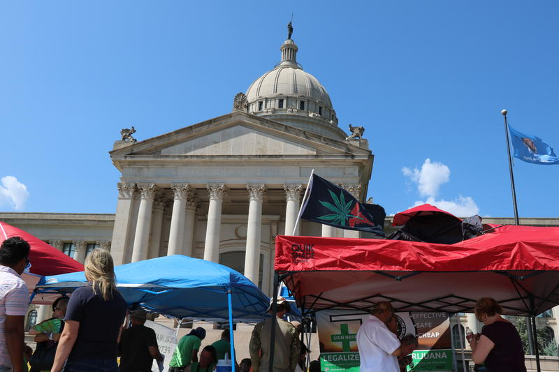 Supporters of medical marijuana gather petition signatures in front of the Oklahoma state capitol on Thursday, Aug. 11, 2016.