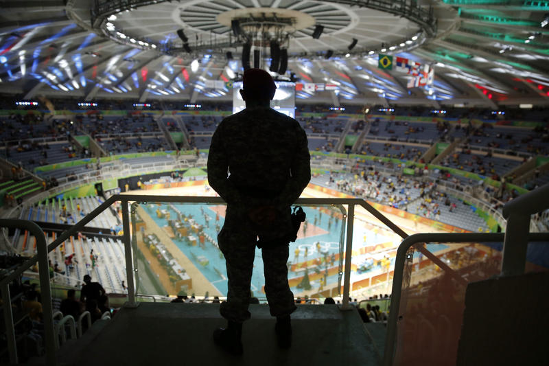 A security official stands guard ahead of a men's preliminary volleyball match between Cuba and Iran at the 2016 Summer Olympics in Rio de Janeiro, Brazil, Thursday, Aug. 11, 2016.