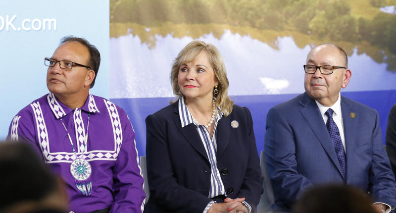 Chief of Choctaw Nation Gary Batton, from left, Oklahoma Gov. Mary Fallin and the Chickasaw Nation Gov. Bill Anoatubby listen to a speaker during a press conference at the Oklahoma Heritage Center in Oklahoma City on Thursday.