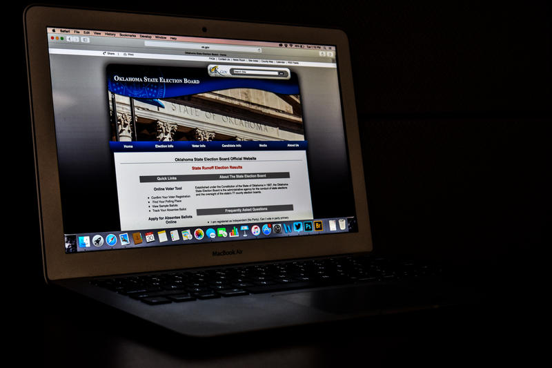 laptop with Oklahoma State Election Board website