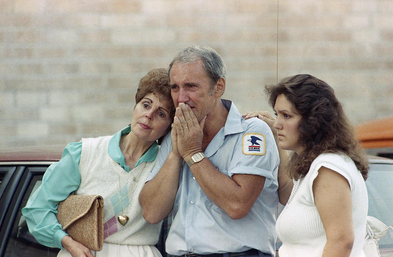 An Edmond Postal employee is consoled following a shooting spree that left 15 people, including the shooter, dead at the Edmond Post Office, Wednesday, August 20, 1986 in Edmond. An additional six people were injured in the shooting.