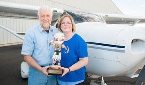 Mac McClure in 2012 receives a volunteer award with Flights for Life Marketing Director Jane Tellier.
