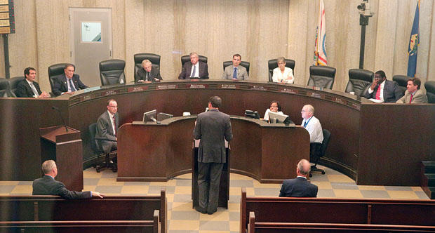 Oklahoma City University economist Russell Evans, at lectern, addresses the Oklahoma City Council Tuesday.