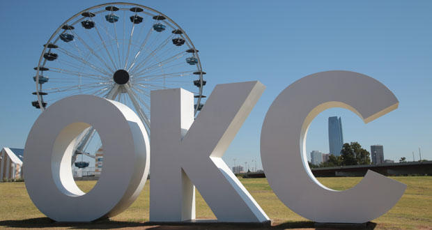 The Wheeler Ferris Wheel is shown behind signage at Oklahoma City's Wheeler District.