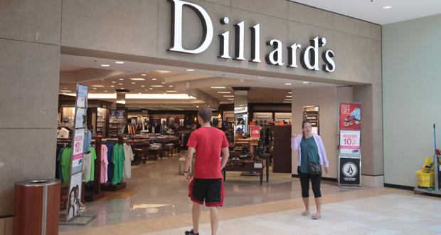 Customers enter a Dillard's department store inside Sooner Mall in Norman.