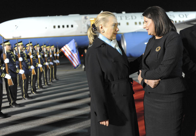 Kosovo President Atifete Jahjaga (right) welcomes U.S. Secretary of State Hillary Clinton upon her arrival in Kosovo's capital Pristina on Oct. 30, 2012.