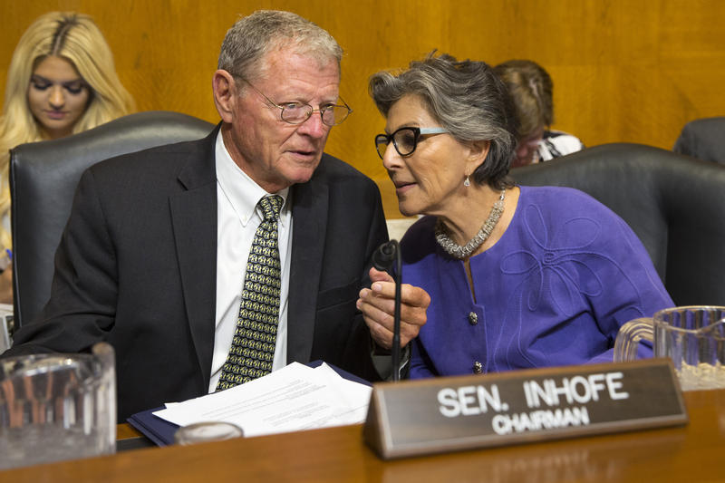 Senate Environment and Public Works Committee Chairman Sen. Jim Inhofe, R-Okla., left, talks with the committee's ranking member Sen. Barbara Boxer, D-Calif., on Capitol Hill in Washington, Sept. 16, 2015.