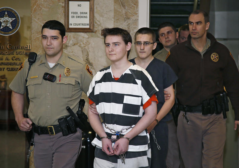 Robert Bever, second from left, and Michael Bever, third from left, are escorted into a courtroom for a hearing in Tulsa, February 23, 2016.