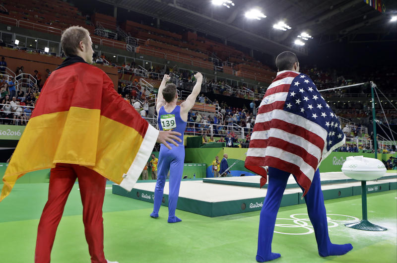 Germany's Fabian Hambuechen, Britain's Nile Wilson, and United States' Danell Leyva celebrate during the medal ceremony for horizontal bar during 2016 Summer Olympics in Rio de Janeiro, Aug. 16, 2016.