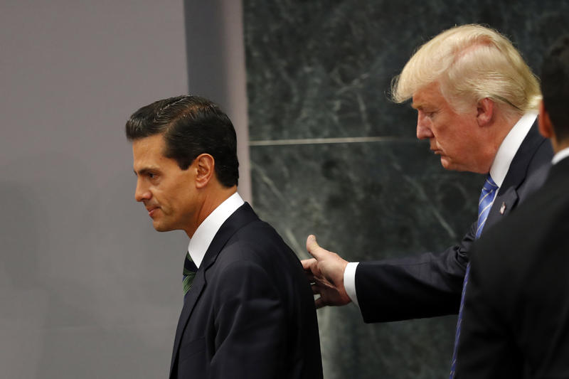 Republican presidential nominee Donald Trump walks with Mexico President Enrique Pena Nieto at the end of their joint statement at Los Pinos, the presidential official residence, in Mexico City, Wednesday.