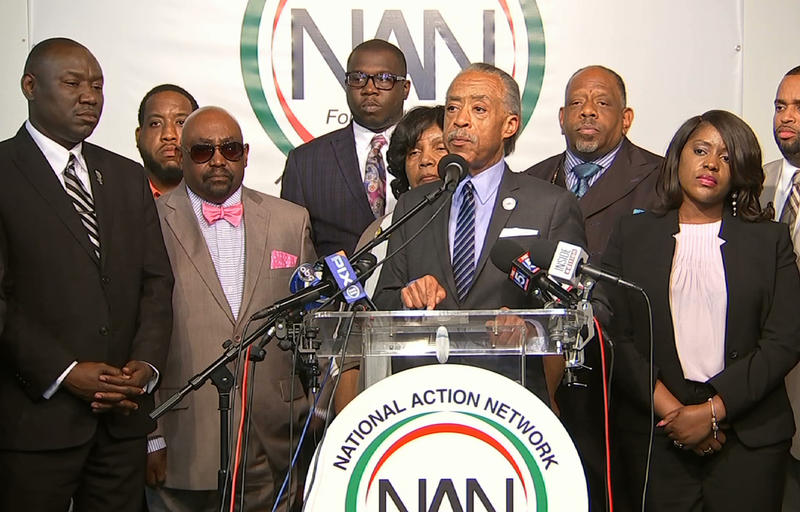 The Rev. Al Sharpton, center, speaks to the media at the National Action Center in New York, Wednesday, Sept. 21, 2016 about the shooting death of Terence Crutcher in Tulsa. He's joined by Attorney Benjamin Crump (right), and Crutcher's father (bow tie).