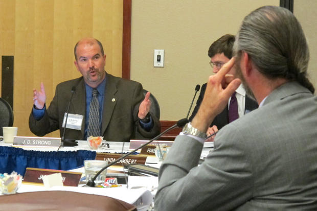 OWRB Executive Director J.D. Strong (left) addresses members of the water board at its Oct. 23, 2013 meeting.