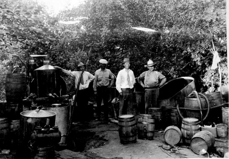 Dep. Sheriff Red Edgman, Dep. Sheriff Dave Harlan, Sheriff Orin Johnston and Henry Troup break up a still near Purcell, Oklahoma in 1933.