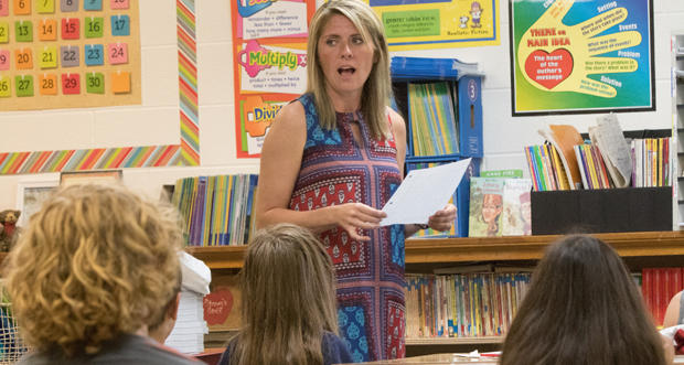 Stacey Haynes goes over spelling words with her third-grade class in Washington, Okla.
