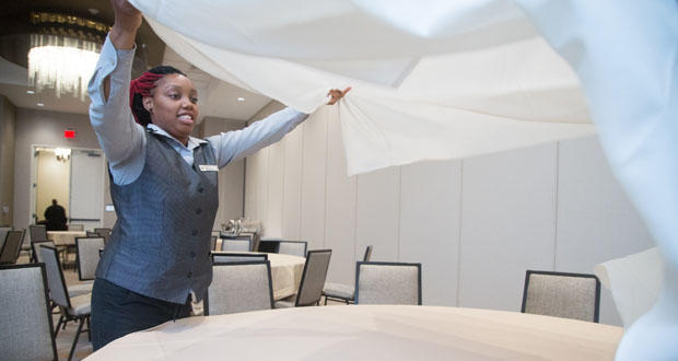 Shekeyra Goodman sets a table in an event room Tuesday at the Embassy Suites Oklahoma City Downtown/Medical Center.