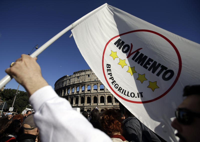 Activists of the anti-establishment 5 Star Movement gather in front of the ancient Colosseum in Rome, Sunday, April 21, 2013.