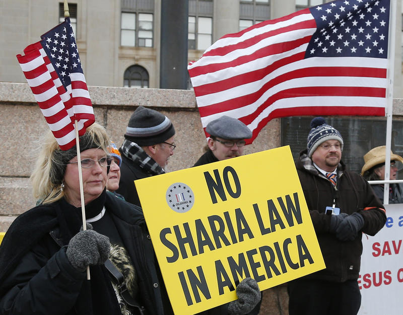 A small group of protestors, who did not want to give their names, stand outside the state Capitol during the first-ever Muslim Day in Oklahoma City, Friday, Feb. 27, 2015.