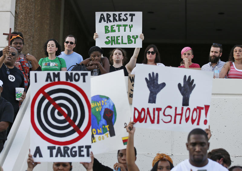 "People hold signs at a ""protest for justice"" over the Sept. 16, 2016 shooting death of Terence Crutcher, sponsored by We the People Oklahoma. The rally took place in Tulsa on Sept. 20, 2016."