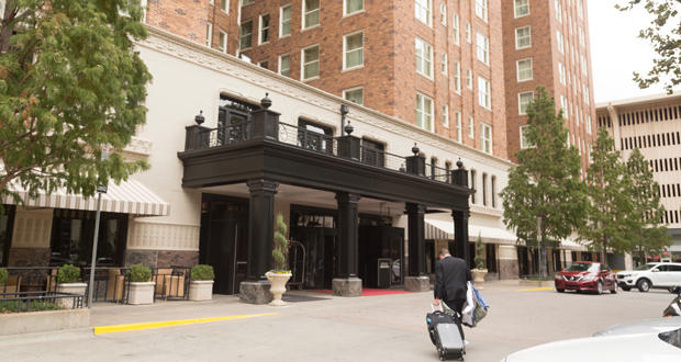 A man enters the Skirvin Hilton Hotel in downtown Oklahoma City Tuesday.
