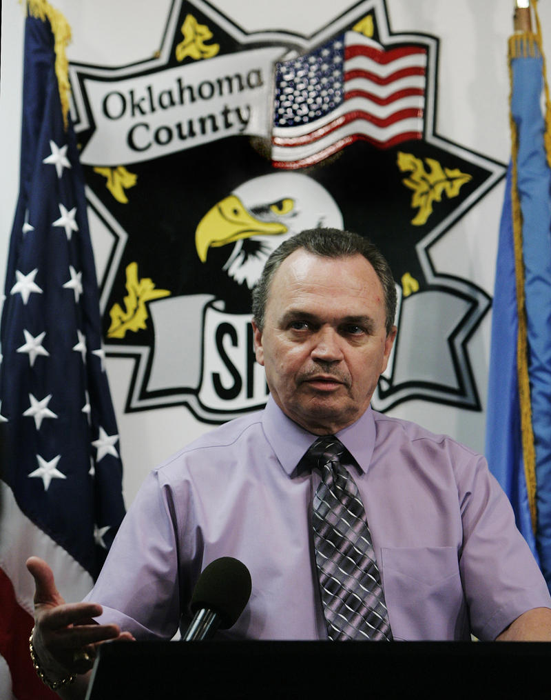 Oklahoma County Sheriff John Whetsel gestures as he answers a question at a news conference in Oklahoma City, Wednesday, July 30, 2008.