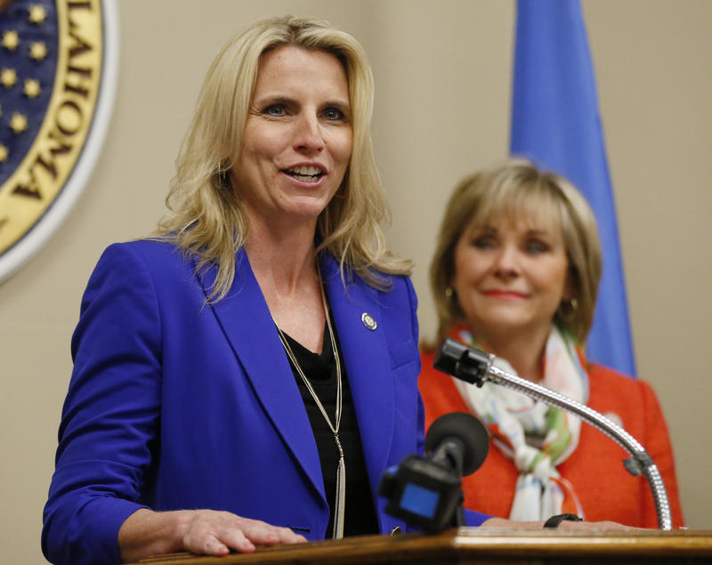 State Sen. A.J. Griffin, R-Guthrie (left), and Gov. Mary Fallin speak at a March 31, 2015 bill signing for a bill requiring doctors in Oklahoma to check a new prescription drug database before prescribing certain addictive drugs.