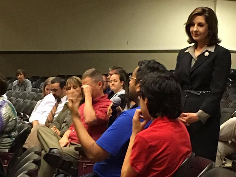 State Superintendent Joy Hofmeister speaks to a student during a Monday evening town hall meeting in Oklahoma City.
