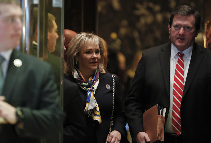 Gov. Mary Fallin and her husband Wade Christensen look out from an elevator as she arrives at Trump Tower, Monday, Nov. 21, 2016 in New York.