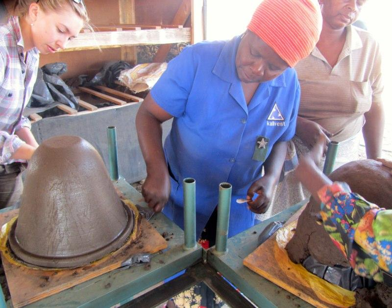 Workers mold clay pots as part of PureMadi's water filtration efforts in South Africa.