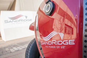 The SandRidge Energy Inc. logo is seen on a vehicle parked at the company headquarters in Oklahoma City.