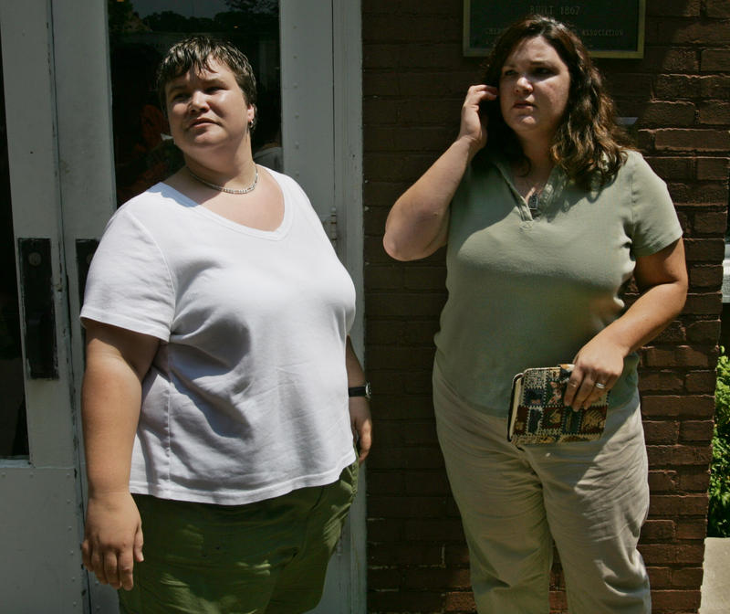 Dawn McKinley, left, and Kathy Reynolds talk to reporters outside the Cherokee Tribal courthouse in Tahlequah, Aug. 2, 2005, where justices heard arguments in a case involving the couple's effort to have the tribe recognize their union.