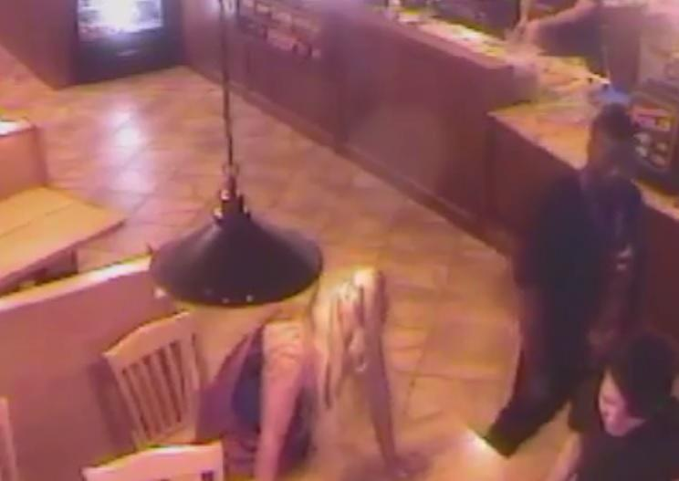 A screen grab from July 25, 2014 surveillance video showing the altercation University of Oklahoma football player Joe Mixon and OU student Amelia Molitor.