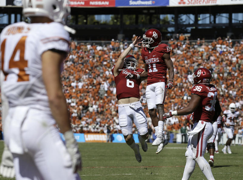 University of Oklahoma quarterback Baker Mayfield (6) celebrates a touchdown pass to wide receiver Dede Westbrook (11) during the second half of the Red River Rivalry game in Dallas Saturday, Oct. 8, 2016. Oklahoma won 45-40.