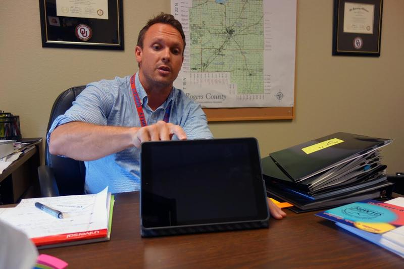 Josh Cantwell, Grand Lake Mental Health Center adult services administrator, demonstrates how the organization's iPad program works to help clients access treatment.