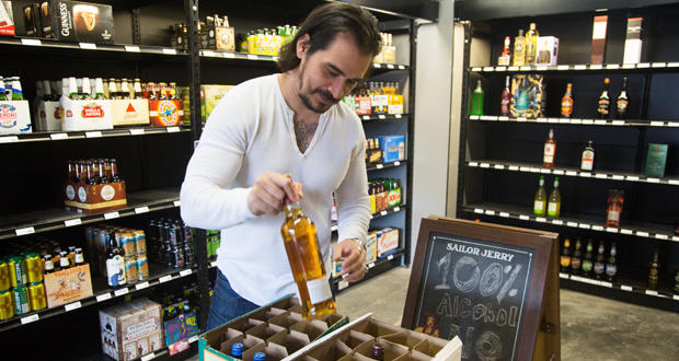 Art Rutledge looks over a shipment of liquor at Vice Spirits, Wine, Beer at 317 N. Walker Ave. in Oklahoma City.