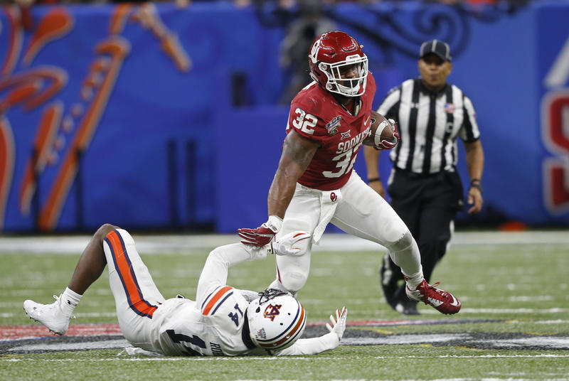 University of Oklahoma running back Samaje Perine rushes past Auburn University defensive back Stephen Roberts in the second half of the Allstate Sugar Bowl in New Orleans, Monday, Jan. 2, 2017.