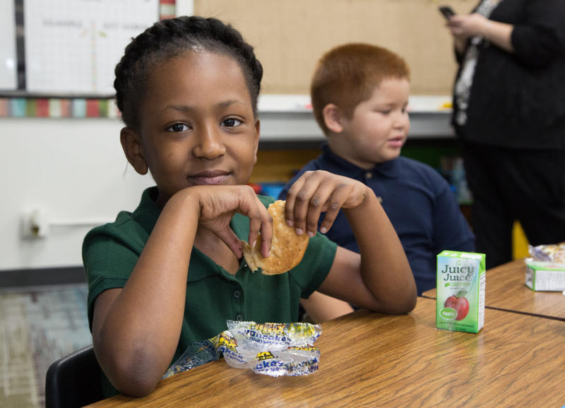 Aubrielle McElroy eats breakfast in her classroom at Remington Elementary in Tulsa. All elementary schools in the Tulsa Public Schools district started offering free breakfast and lunch to all students without requiring applications at the start of the sc