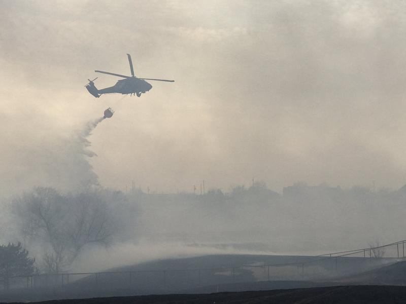 Bambi bucket helping to gain control over this massive grass fire.