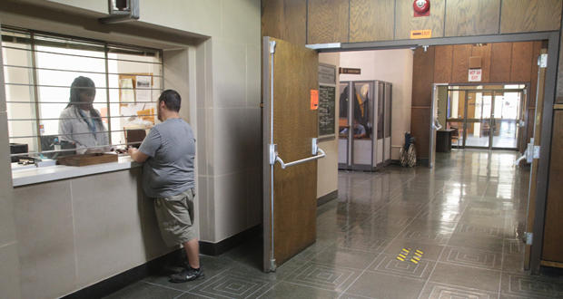 A customer pays a bill at the customer service window at the Oklahoma Corporation Commission in Oklahoma City.