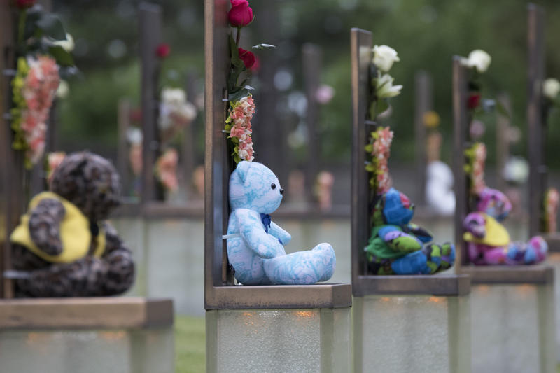 On the 22nd anniversary of the Oklahoma City bombing, roses, wreaths and teddy bears decorated chairs representing the children killed at the Alfred P. Murrah Federal Building on April 19, 1995. There are 168 chairs in total—one for each adult and child w