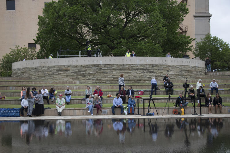 Ceremony attendees gathered in front of the reflecting pool at the Oklahoma City National Memorial and Museum. (April 19, 2017).