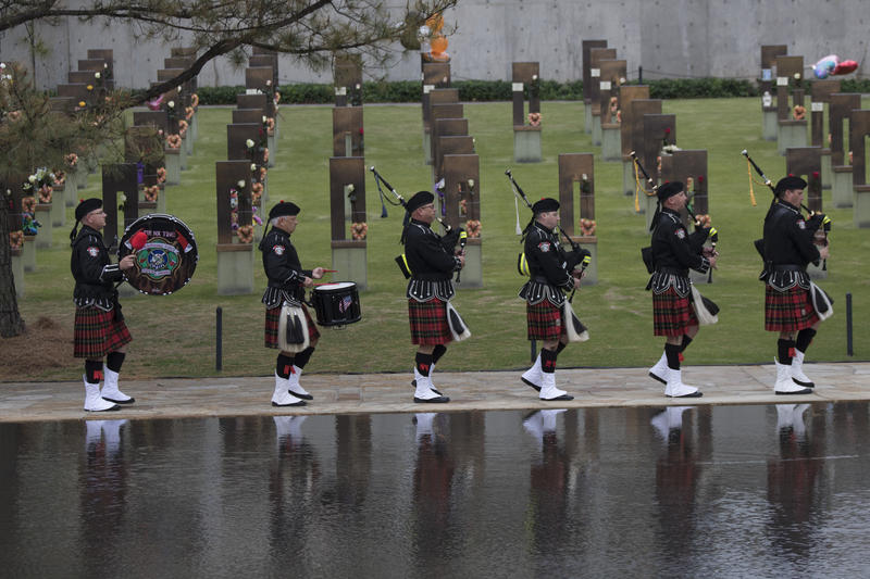 Oklahoma City Fire Department bagpipe players processed along the reflecting pool at the memorial. (April 19, 2017).