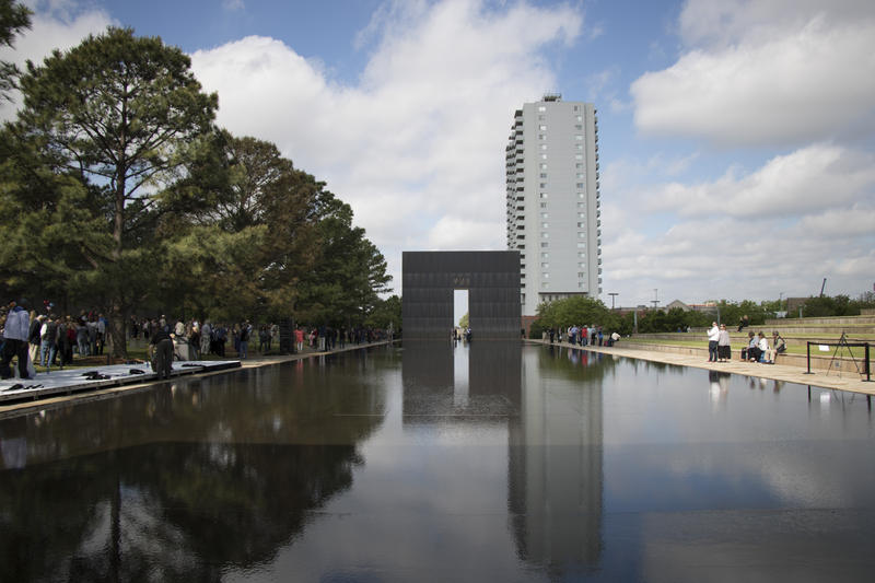 The crowds at the Oklahoma City National Memorial dispersed after the remembrance ceremony was over. Family members and supporters gathered around the chairs, taking pictures, placing flowers and other mementos and reminiscing. (April 19, 2017).