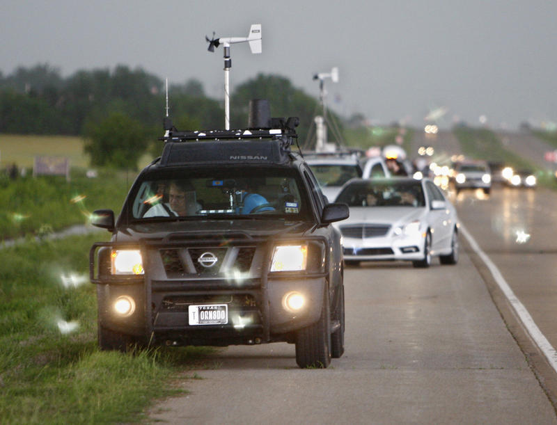 In this May 19, 2010 file photo taken near Kingfisher, Okla., storm chasers and spectator vehicles clog the road and shoulder of Highway 81.