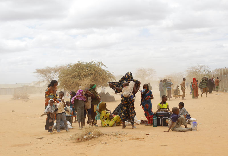 Somali refugees wait outside a UNHCR processing center at a refugee camp outside Dadaab, eastern Kenya, on Aug. 5, 2011. Climate change contributed to low rain levels in East Africa in 2011, making global warming one of the causes of Somalia's famine.