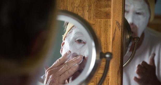 John Pansze, of Yukon, applies makeup to get into character as Sponji the Clown.