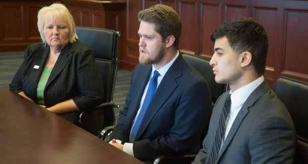 Oklahoma City University law students Sonya Chronister, Cameron Farnsworth and Marcos Sierra talk about the Oklahoma Innocence Project's latest work while sitting in the J. William Conger Courtroom at the OCU School of Law.