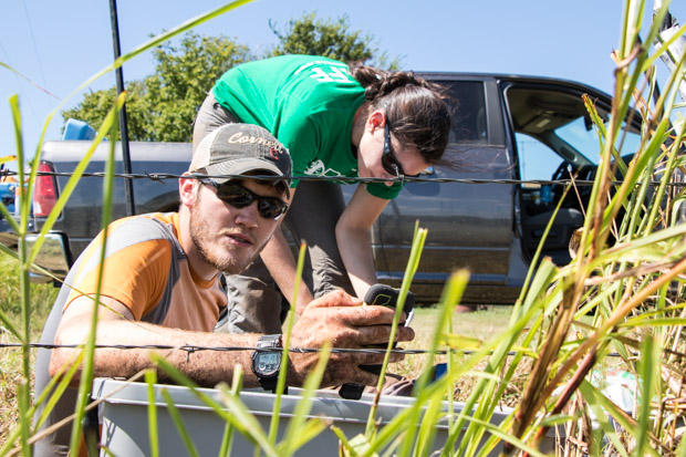 Researchers Nate Stevens and Hannah Rabinowitz calibrate a seismometer near Pawnee, Oklahoma.