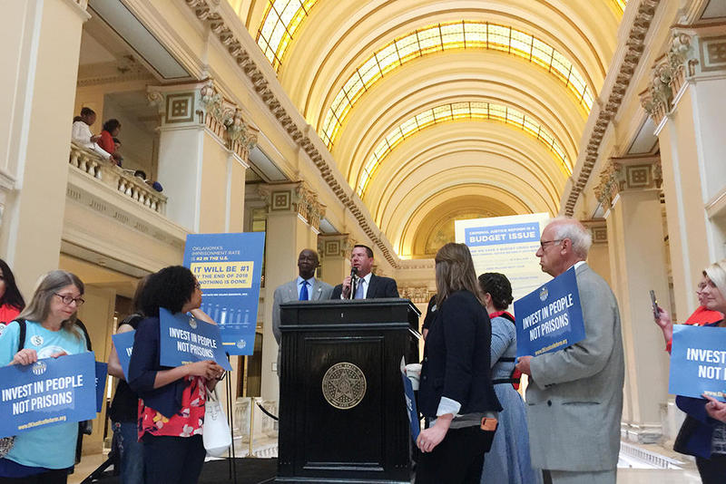 Former House Speaker Kris Steele (right) and Rep. George Young (left) speak at the podium during the Rally for Criminal Justice Reform today at the Oklahoma State Capitol.