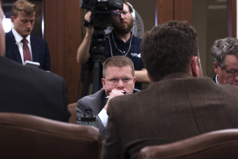 Lawmakers sit in the House Joint Committee on Appropriations and Budget on Tuesday night.