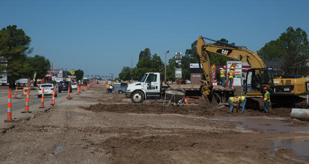 Motorists travel past construction on Lindsey Street in Norman.